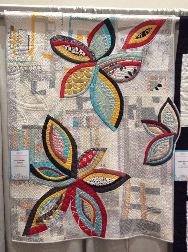 Unexpected Blooms by the Sacramento Modern Quilt Guild